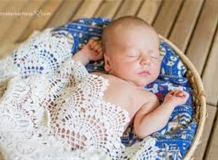 Newborn babyboy in the basket
