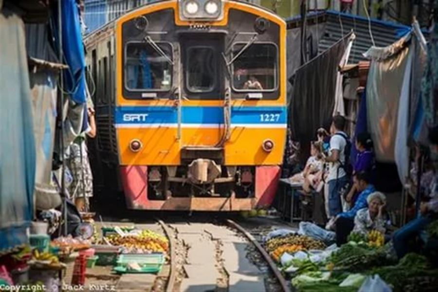The Commuter Train Runs Through Samut Songkhram Market
